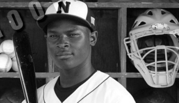 Senior Kalob Russell posing for North High's spring baseball pictures