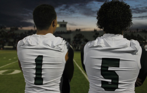 Caleb Lara #1 standing on the sidelines with Trey Warrick #5, during the North/East game Sept, 5, 2014
