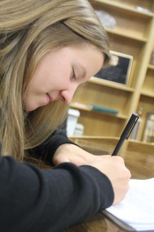 Moriah Ross signing her scholarship