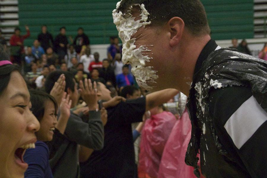 School Improvement Leader Ben Graeber gets pied in the face for charity. With at least a $1 donation to UNICEF, students got the chance to pie their favorite teacher in the face.