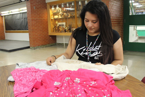 Stephanie Rivas, sophomore, shows off her recycled fashion she