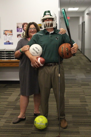 New Athletic Director OJ Sinclair and Athletic Secretary Terri Buban pose showing just some of the sports here at North High.