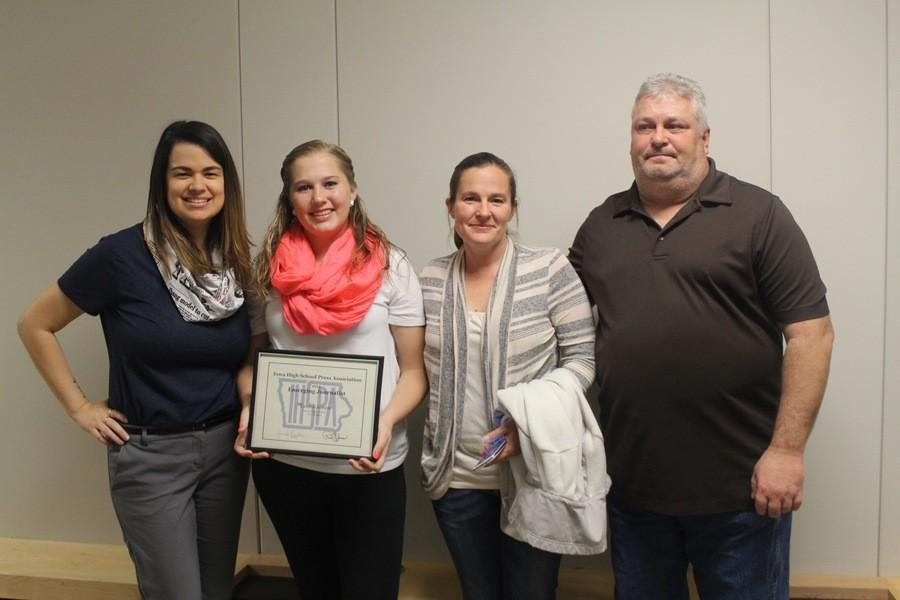 Jones showing off her new award with her parents and advisor on Tuesday, November 3rd at the Des Moines school board meeting.