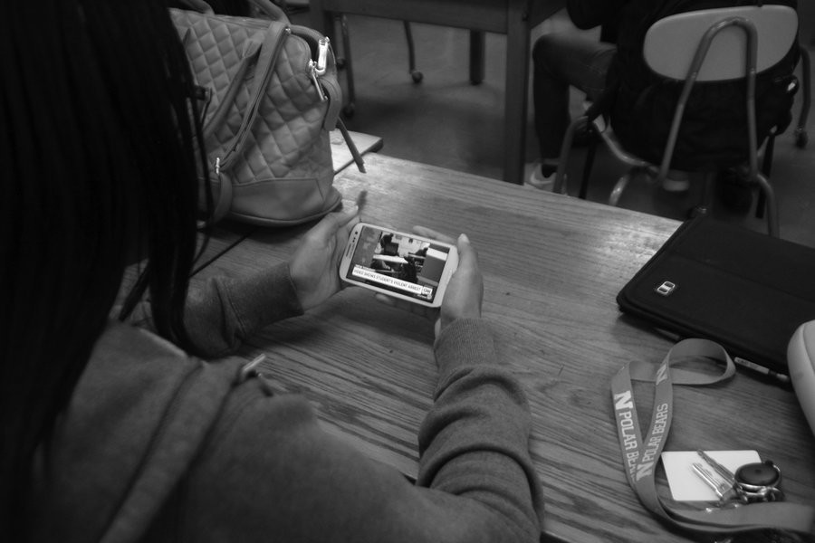 Eleventh grade student Amirah Avant watches the shocking video of the infamous incident. Photo Credit: Angelica Reyes