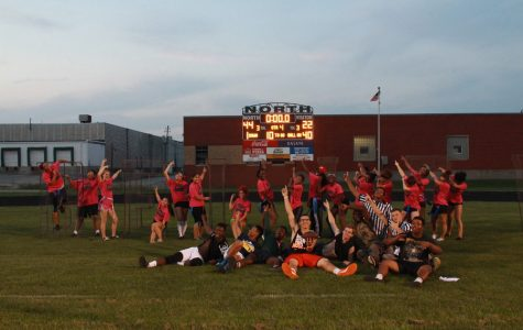 Seniors pose by the score board, ecstatic from their win.