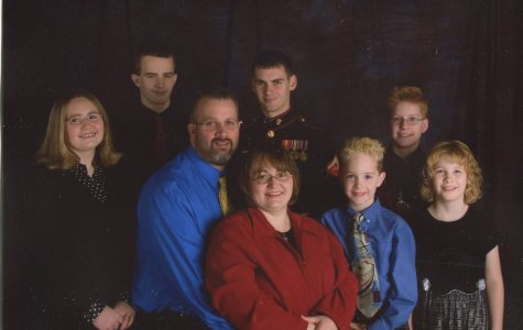 John Kerr, math teacher at North, and his wife Judy have fosters around 100 children and have adopted three children to join their family, making their count to eight.