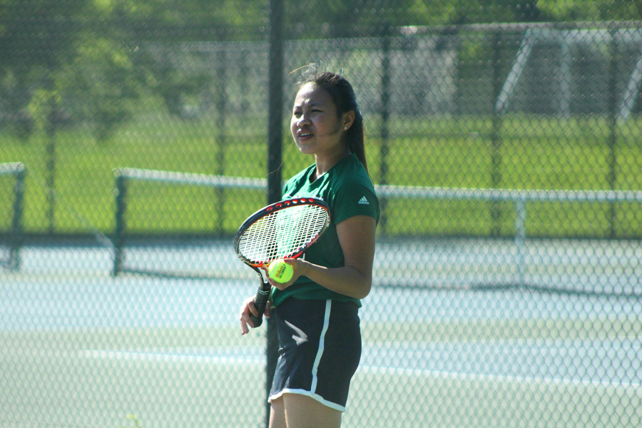 Junior%2C+Paw+Mu+So+confirms+the+score+with+her+opponent+before+she+prepares+her+serve.