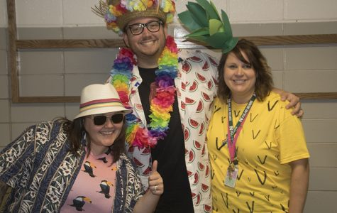 Amy and Jeff Rost pose with Lori Bonstetter for Tropical Tuesday.