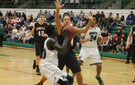 North boys basketball wins over rival East