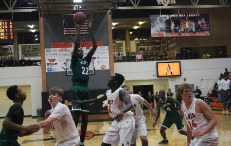 Varsity Boys Basketball Vs. Ames High school
