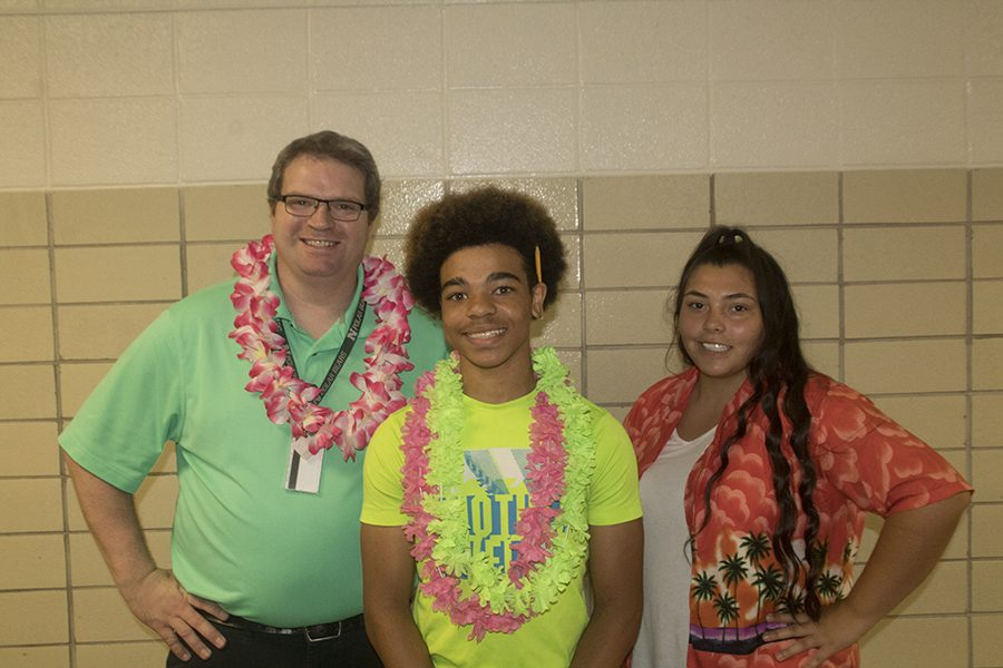 English teacher Nathan Fredericks and juniors Greg Oats and Natalia Guerrero celebrate Tropical Tuesday.